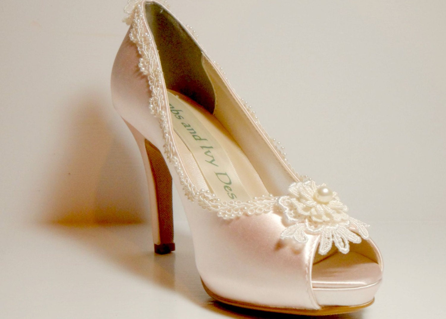 blush pink lace and pearl wedding shoes by lambsandivydesigns