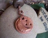 waning moon copper disc pendant with smoke fired bead