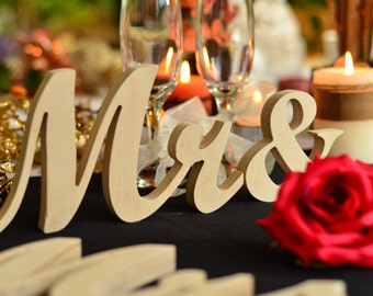 Decorate the wedding table with mr and  mrs signs for wedding table decoration. Top table Mr&Mrs sign - painted, glitter, not painted