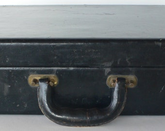 Vintage attache case, black leather, made by Leather Specialty Company, worn, hardsided man's luggage from Diz Has Neat Stuff
