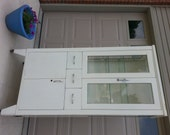 ITEM IS RESERVED.  1950s shampaine co. medical hospital style metal cabinet with glass doors