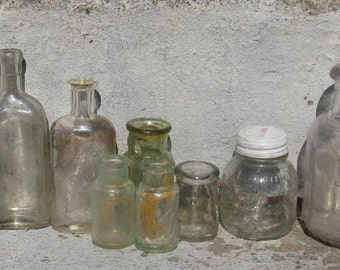 antique bottle collection clear glass assorted shapes and sizes altered art crafts embellishing
