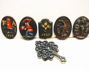 Vintage Wilton wrought iron medallions and trivet fireman lock covers