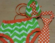 cake smash outfit, first birthday outfit, green and white chevron and orange trims birthday outfit
