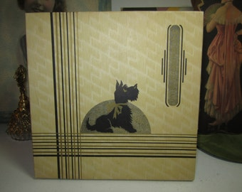 Colorful art deco 1930's-40's gold gilded handkerchief box with cute black scotty dog wearing a gold gilded bow with original unused hankies
