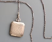 Antique Arts & Crafts Sterling Locket with Chain.