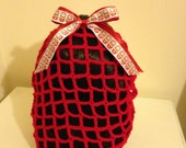 Red crochet snood with Russian doll bow