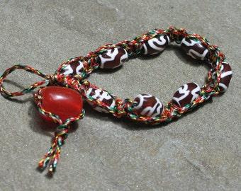 Mini lotus dzi bead bracelet by Nicole Wong
