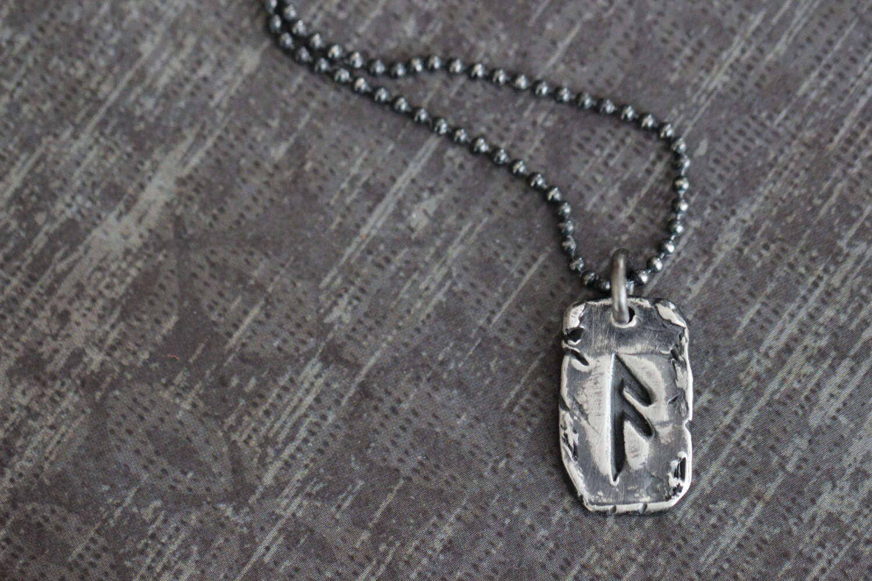 fehu rune charm sterling silver rune charm elder futhark
