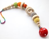 Pacifier clip, dummychain holder. Teething toy with crochet wooden beads. Multicolor rattle for baby.