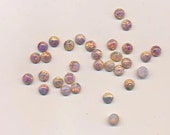 Fifty vintage glass opal flat-backed cabochons with opalescence - 6.8 mm