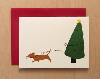 Dachshund runs away with tree lights - Set of 8 Cards