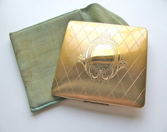 Vintage compact with fabric case