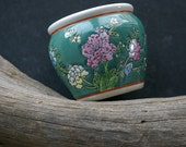 Sweet Little Round Green  Vase With Pink, White, Yellow and Blue Flowers All Around