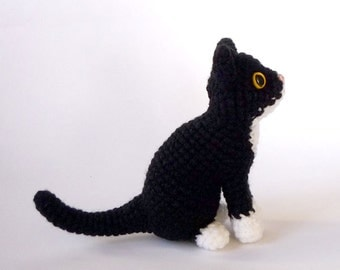 Realistic black and white tuxedo cat amigurumi