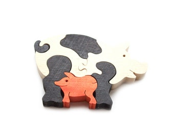 Best price Wooden Puzzle Pigs. Handmade puzzle game that develops motor skills. Toy for children.