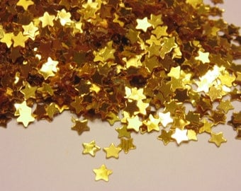 bag of small / tiny gold star confetti , 4 mm (9)+
