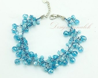 Aquamarine crystal hand knotted on silk bracelet.