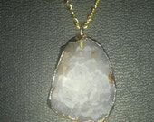 Lavender faceted druzy wrapped in gold