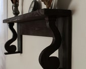 Handmade, hanging mantel shelf with scrolled corbels