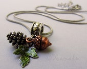 Autumn Pendant Necklace With Silver Pine Cone, Copper Acorn And Green Leaf Charms
