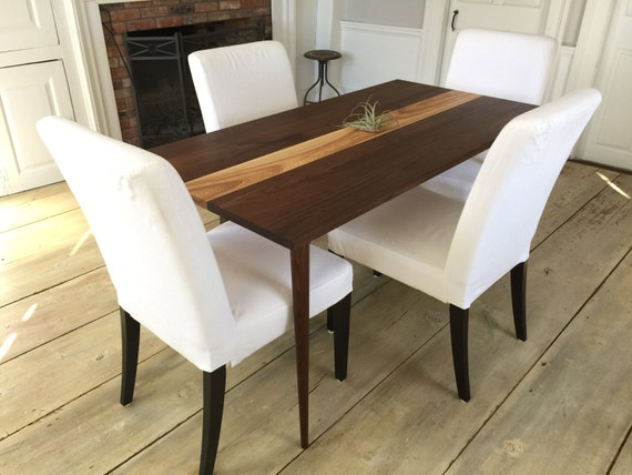 Mid century modern dining table, black walnut & ash with tapered wood legs.