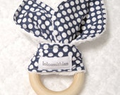 Natural wooden baby teether bunny ears in dark blue and white polka dots