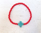 Turquoise cross bracelet with red seed beads