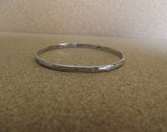 Sterling Silver Bangle With Bows