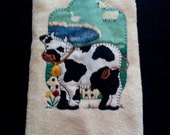 Vintage dish towel with the still popular cow. Styles come and go and the cow has come back.