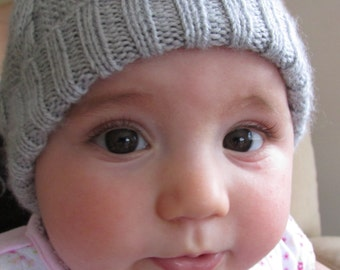 Baby cable hat with pom pom