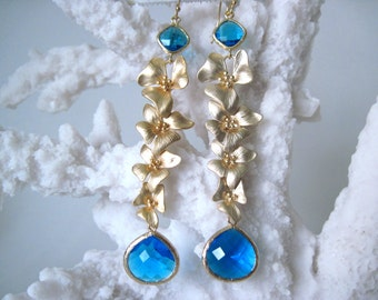 very long gold  earrings with teal drops