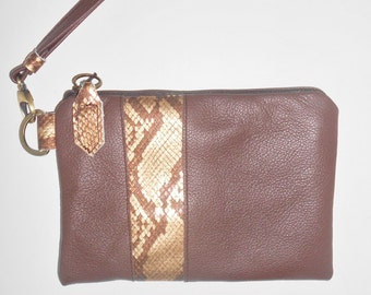 Leather wristlet or clutch in brown leather with embossed snakeskin leather trim.
