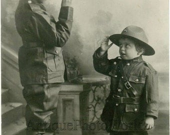 Boys as soldiers saluting each other antique photo