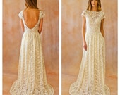 Ivory or White Lace Bohemian BACKLESS WEDDING GOWN. simple and elegant wedding dress with open back and pockets so elegant. Cap sleeves.