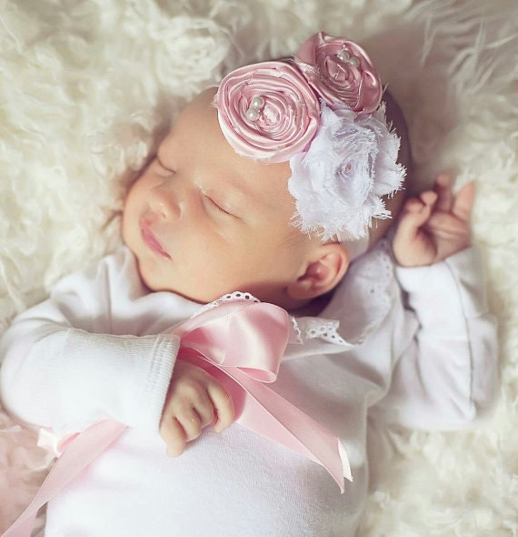 """As a mom of three girls, ages 31/2, 2 and 7 months, Bean knows all about shopping for the ultimate baby girl coming home outfit. While her first daughter wore a """"soft pink gown with white lace details,"""" Bean concedes that wasn't the best choice trying to buckle baby into the car seat."""
