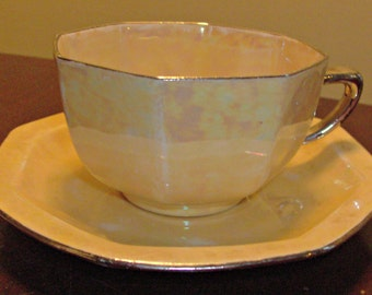 Vintage Steubenville Yellow Iridescent Teacup and Saucer