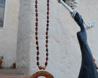 Red and brown beaded necklace with pendant