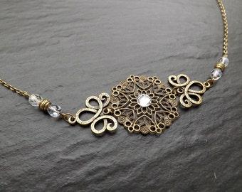 "headband ""may"" composed of Crystal beads and a cabochon swarovski"