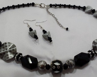 Silver and black necklace & earring set.