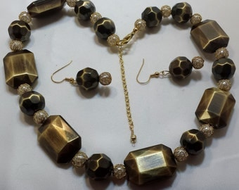 Antique gold necklace and earring set.