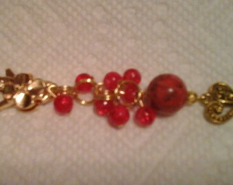 Gold flower charm purse, phone, key chain or zipper pull