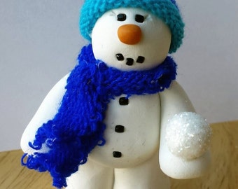 Snowman holding Snowball Ornament
