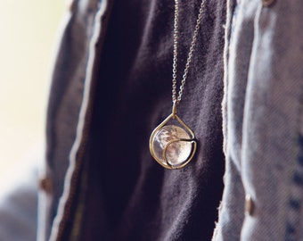 quartz crystal sphere oracle crystal pendant encased in sterling silver on a sterling silver chain