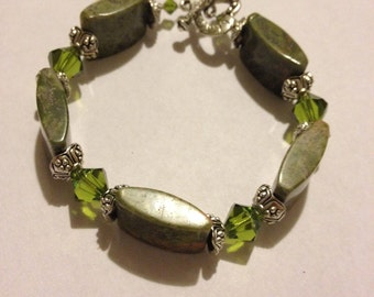 green stone and crystal bracelet with silver accents