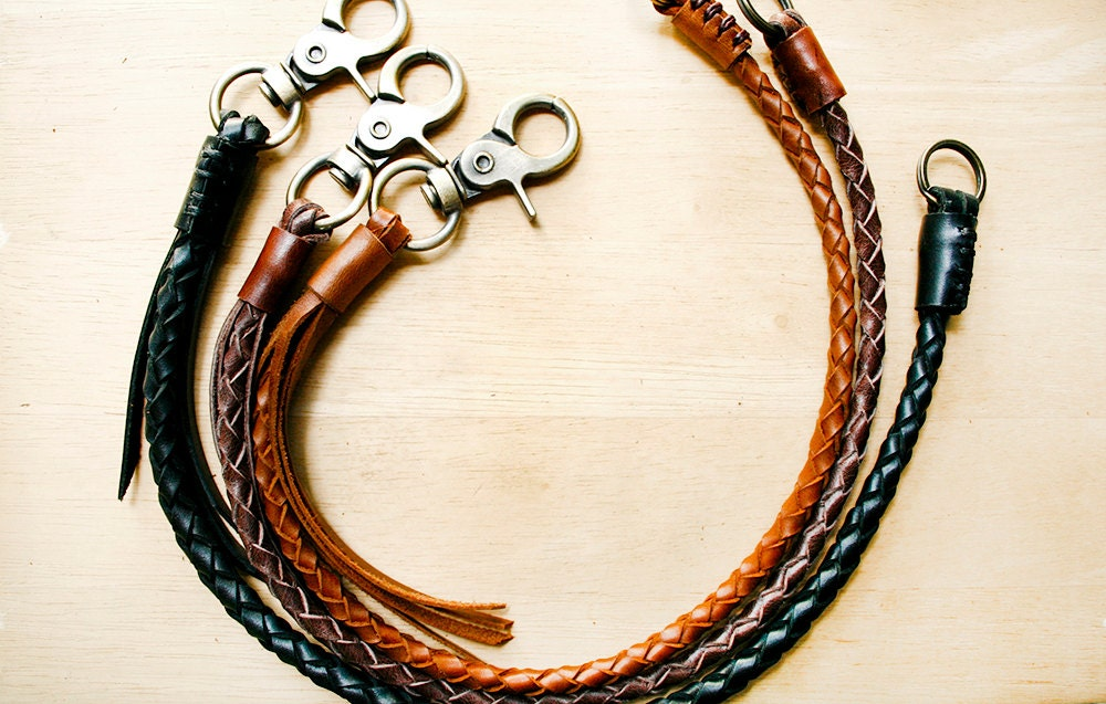 Custom hand braided leather lanyards can attach to about anything. Durable deer and elk leathers with a strong core and split rings can attach to badges, whistles or anything else that you need connected.