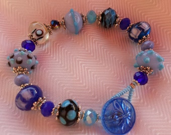 This is a beautiful blue button bracelet that is around 8 inches in length.