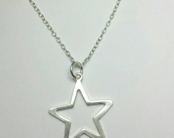Sterling silver star necklace / Simple star pendant / modern / Boho necklace / Handmade in the UK / Silver pendant