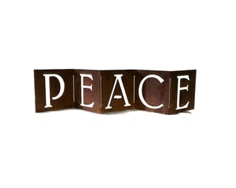 """Mantel Silhouette """"Peace"""" with a Rusty Patina"""