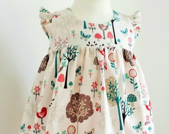 Flutter Sleeve Empire Waist Baby Girl Dress Cream Coloured With Woodland Scene Print